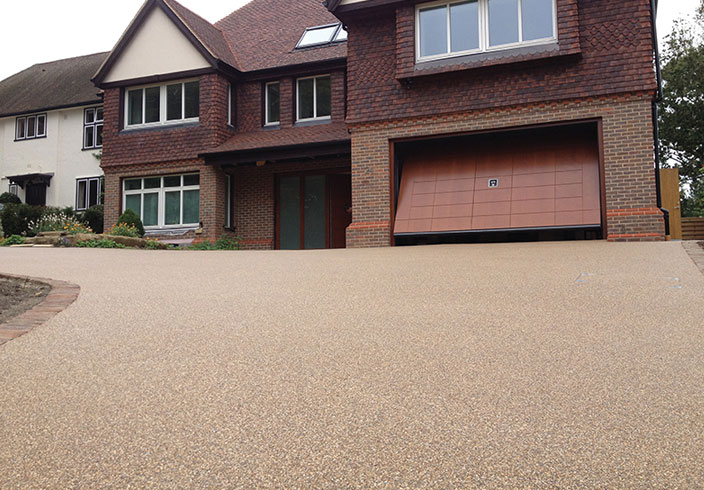 Resin Bound Gravel Driveway in Flaxen Pea colour, Reigate, Surrey installed by Clearstone