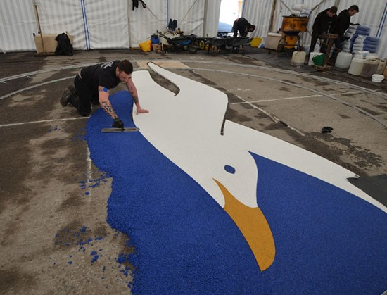 Clearstone installing resin bound Albion Seagull logo - Amex Community Stadium Brighton
