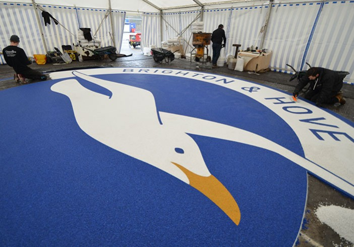 Martin Perry checking Clearstone's resin bound Albion Seagull logo - Amex Community Stadium Brighton