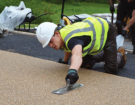 Hand-trowel resin bound permeable surface