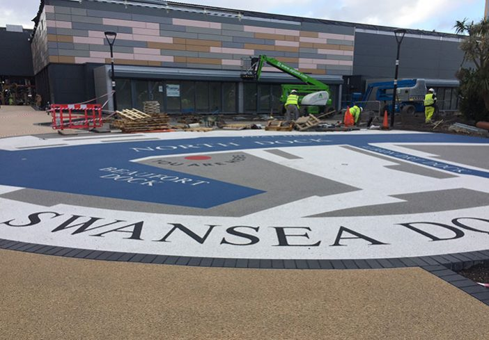 Resin bound colour way-finding graphic, Parc Tawe retail park Swansea