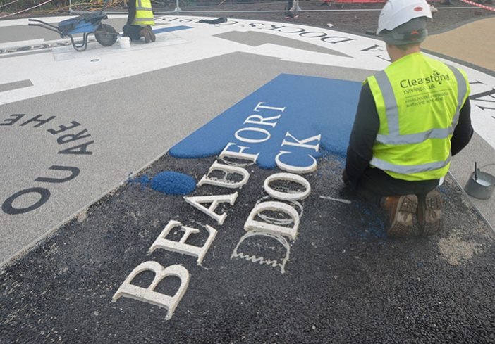 Resin bound colour way-finding dock side graphic, Parc Tawe retail park Swansea