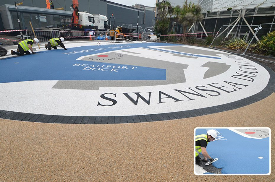 Resin bound wayfinding graphic for decorative landscaping paved forecourt at Parc Tawe Retail Park