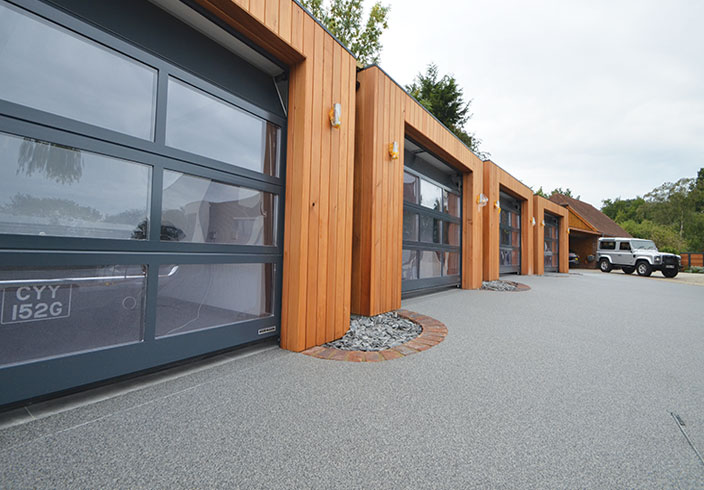 Resin bound drive for luxury garages A Room in My Garden Cuckfield, Sussex